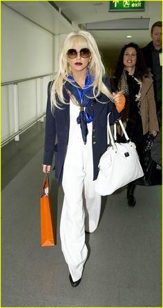 Lady Gaga wearing a chic summery outfit with a blue silk scarf and a Hermes bag