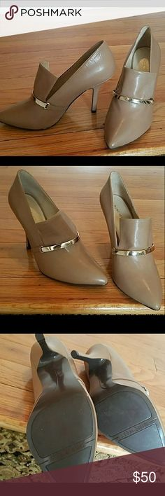 NEW NINE WEST HEELS Nice Nine West heels. Never worn, 4 inch heel. Nice tan color matches most outfits. Nine West Shoes Ankle Boots & Booties