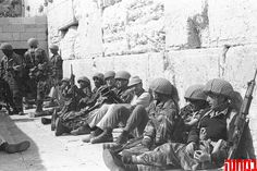 June 7, 1967 - IDF soldiers liberated the Old City of Jerusalem. Soldiers rest against the imposing stones of the Western Wall. (Credit: BaMachaneh)