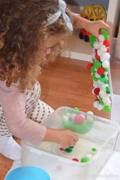 A fun and easy sensory bin activity using frozen pom poms! Great fine motor skill activity for toddlers and preschoolers. #toddler #preschooler #toddleractivity