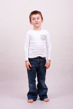 T-shirt with long sleeves, printed design at front. Made of 100% cotton. Three small buttons at front, round collar. Material is safe in contact with sensitive skin of your baby.