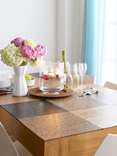 DIY Cork Table Makeover:  Overhaul a damaged tabletop with cork tiles. Working with a varied selection of cork tile, plan a checkerboard pattern on the tabletop. (Via bhg for the how-to.)