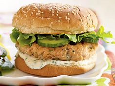 Fresh Salmon-Cilantro Burgers | Skip the beef and serve a Mexican-inspired salmon burger topped with a fresh lime-cilantro mayonnaise sauce. Cook the salmon patties in a skillet to enjoy this hearty burger year-round. A spinach salad with a sweet, slightly spicy Asian-influenced dressing makes a tasty accompaniment.
