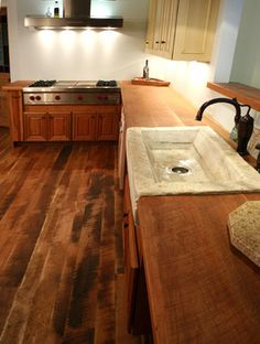 A little too much wood with the cabinets too. But love the floor, counter and sink.