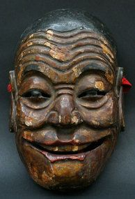 Chinese Nuo Mask of the smiling monk He Shang from the Tujia people of Guizhou.