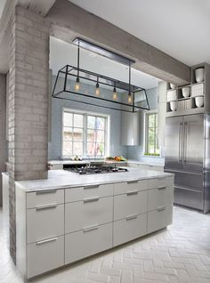 Modern kitchen neutral palette. Exposed brick wall column painted gray!  Perfection. http://cococozy.com