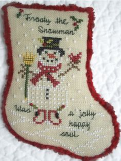 Frosty The Snowman is the title of this cross stitch pattern from JBW Designs. The price includes the cross stitch pattern and the charm as shown in the photo.
