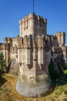 CASTLES OF SPAIN - Castle of Coca located in the city of Coca (birthplace of Roman Emperor Theodosius), province of Segovia, It is an excellent example of the Gothic and Mudéjar styles. It is considered to be the highest example of brick military architecture. Castle of Coca was built in the 15th century with the help of the powerful Archbishop of Seville Alonso de Fonseca, who in 1453 received permission to King Henry IV of Castile on the construction of the castle.