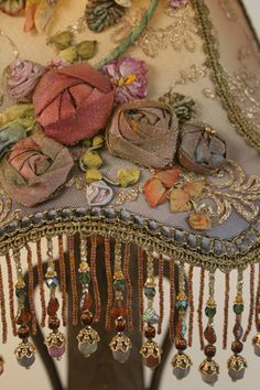 Detail of victorian ribbon roses on ornate victorian art nouveau table lamp - stunning!
