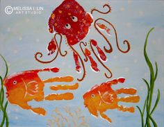 Handprint art.  Mommy octopus and the two little fishes.