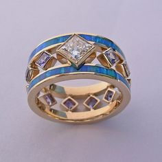 14 Karat Gold, Diamond, Opal, and Tanzanite Ring