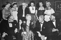 Hollywood celebrates Ethel Barrymore's 70th birthday at George Cukor's palatial home, with (standing l. to r.) Billie Burke, Judy Garland, Lucile Watson, Katharine Hepburn, Constance Collier, and Laura Harding, and (seated l. to r.) Lionel Barrymore, the birthday girl, Spencer Tracy, and the director-host. | TUMBLR.COM