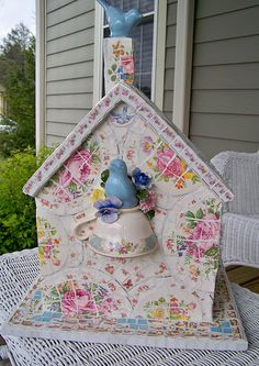 Mosaic birdhouse made with broken dishes
