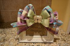 Love the ribbon and butterfly on this frame. It would look so cute mixed in with spring decor