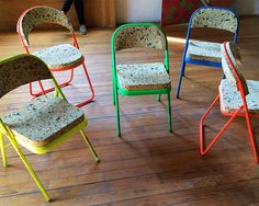 pre-existing folding chairs were painted with neon paints and modified with the addition of recycled chip foam