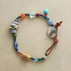 "LEFT COAST BRACELET -- Jes MaHarry combines rare trade beads with hand-cast sterling silver charms, leather with turquoise, apatite, carnelian, kyanite, and aquamarine in an eye-catching bracelet with an easy West Coast vibe. USA. Exclusive. 7"" to 8""L."