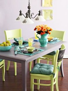 An off kilter double split complementary colour scheme - an intriguing and refreshing combination resulting in a handsome and fresh looking room. A Brilliant play on the Gelati hues of Lavender, Acid Yellow-green and Turquoise Blue-green, with a hit of Apricot Orange and Graphite Grey.