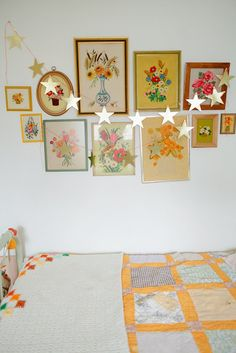 of course I'd love this... stars draped and colorful vintage stitched flower art, and a great bed quilt ... the boo and the boy: eclectic kids' rooms with a vintage and boho vibe Granny Chic, Little Girl Rooms, House Colors, Girls Bedroom, Bedrooms, Star Garland, Star Banner, Home And Family, Vintage Embroidery