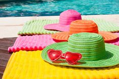 Straw hats for a party gift- (girlfriend get-together?) I'm thinkin of filling colorful straw hats with sunglasses, suntan lotion, a book, a fancy plastic glass with a straw and decorative umbrella, etc.