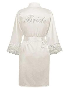 Sexy silky robe with Bride on the back side in rhinestones  Are you preparing for your big day? This sexy Dyme piece is to die for.   Pamper up as you get ready to say I Do.💐