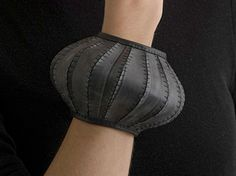 Bangle | Tassia Joannides. 'Panel stitch' Hand cut panels of bicycle inner tubes