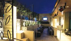 Outdoor night club seating heated by Bromic Heaters