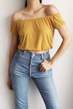 "- Details - Size - Shipping - • 95% Rayon 5% Spandex • Soft stretch off shoulder rib top. • Hand Wash • Line dry • Imported • Measured from small • Length 12"" • Chest 17.5"" • Waist 12"" - Free domestic"