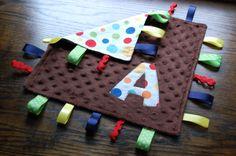 "LOVE this ""taggie blanket"" idea!!"