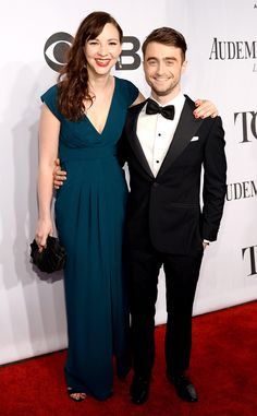 The pair is all smiles on the red carpet—The Cripple of Inishmaan actor wears Ermenegildo Zegna.