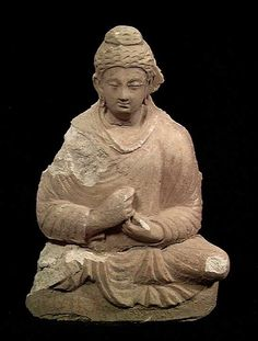 9797. GANDHARA STUCCO BUDDHA, ca. 2nd-4th century AD. The seated Buddha with long robes and clasped hands. 9.5 inches. Repaired and chip to r. shoulder but of nice style with good detail. Inexpensive example.  http://www.edgarlowen.com/b4448.jpg