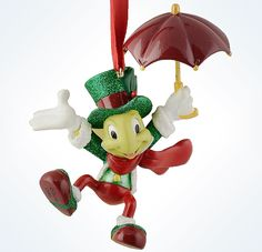 This resin Jiminy Cricket ornament adds up to lots of fun! This keepsake authentic Disney Parks ornament includes a red ribbon for hanging. - Cheshire Cat from Disney's Pinocchio with a Christmas them