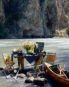 A day on the river fly fishing with a fancy table spread out for lunch by a crafty outfitter.  Along the Gallitin River, Montana