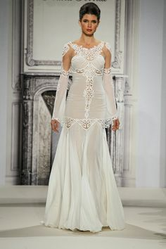 This one is the most unique I have see thus far. love the sleeves. love the cut outs and their placement. this is a killer piece of wedding gearPnina Tornai Wedding Dresses Photos on WeddingWire