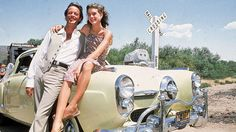 Brooke Shields sitting on top of a Studebaker with arm around co-star Peter Fonda on location for the film 'Wanda Nevada'. (Photo by Julian Wasser/Time & Life Pictures/Getty Images)
