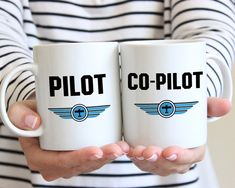 Aviation Gifts, Gifts for Pilots, Coffee Mugs, Pilot Gifts, Aviation Wedding Gift  Coffee mugs for the Pilot and Co-Pilot! This fun and modern coffee mug set is the perfect gift for any aviation loving couple! A fun gift for pilots, future pilots, military aviators and flight school graduates too! Available in three sizes and your choice of custom colors, our mugs feature professionally printed, original designs guaranteed to be treasured for a lifetime. NOTE: Listing is for TWO mugs, one…