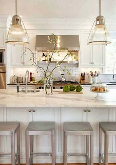 Stainless stools are a good idea; match the appliances, don't have to worry about matching wood color.
