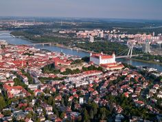 The monumental building of the Bratislava Castle is visible from a great distance. Certainly, every visitor of Bratislava notices the pronounced silhouette. The majestic impression is enhanced by the hill it stands on, some eighty-five metres above the water level of the Danube river. European People, Danube River, Bratislava, Historical Sites, Ancestry, Geography, Paris Skyline, Dolores Park, Castle