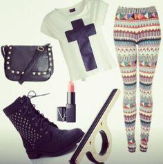 White and black cross shirt , tribal leggings , black combat boots , ring , pink lipstick , black purse