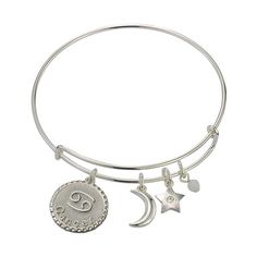 """Stack up with a personal bracelet that lets your unique style shine through.It's written in the stars that you'll love this bangle that features your zodiac charm alongside a moon and star charm. Talk about an astronomically stellar accessory.FEATURES• Adjustable wire bangle• Double-sided zodiac charm• 2 ½"""" inside diameterMATERIALS• Shiny silvertone plating• SteelImported"""