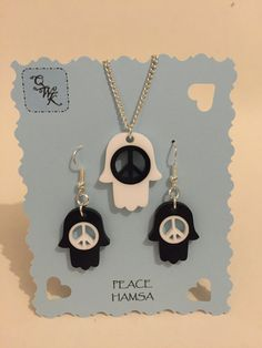 This peace hamsa earring and necklace set will add a bit of peace and spirituality to your look. Whether you are strolling through nature or soaking up the atmosphere in your favourite night spot. These lovely peace hamsa products will feed your inner zen!  In its simplest form the symbol for Hamsa is the hand. It is talismanic symbol that they believed would protect them from harm against the evil forces and bring them goodness, abundance, fertility, luck and good health.  Hamsa charms are…