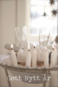 sand in a tub with candles.......scandinavian blog