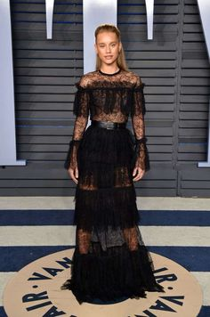 ...in a black lace design with tiered ruffles. - Getty