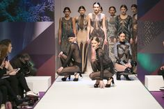 Choreographed exquisitely, the models pose for the end of the scene. Showcasing a mixture of body suits and dresses, featuring a lot of sheer materials and jewel-  and pearl-embellishments, the models please the audience with some incredible and beautiful statement looks on the Spirit Stage catwalk. Olympia London, Body Suits, Sheer Material, Aw17, Exclusive Collection, Catwalk, Embellishments, Jewel, February