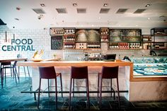The Food Central is a modern cafe/deli, restaurant and wine bar.  Divided up into 4 food islands serving food from the West and Asia.  Designed by RED Design Consultants located in Shanghai, China.