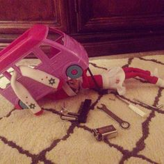 Elf on the shelf working on her car..