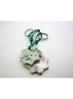 Llavero de cerámica estrella ocho puntas