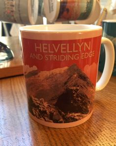 Helvellyn - The Lake District National Park.  A Northern Line Mug created from an original graphic poster designed in The Northern Line studio in Ulverston, Cumbria. We ship worldwide.