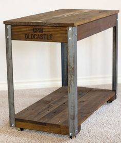 Rustic industrial coffee / side table 17 wide x 31 long x 25 3/4 tall. Set up on caster wheels for easy movement, 1 1/2 angle iron support legs $280