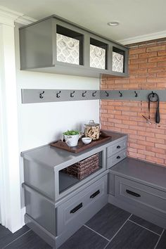 This mudroom nook is the perfect spot to hang outerwear store sports gear and keep odds and ends organized The ceiling-height cabinets serve as gre … – Mudroom Entryway Corner Storage, Entryway Storage, Entryway Decor, Bin Storage, Storage Ideas, Shoe Storage, Entryway Bench, Small Entryways, Small Hallways