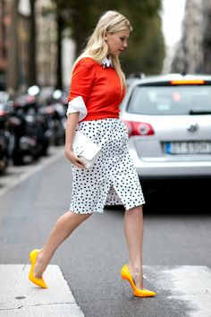 Wear a red crew-neck sweater and a white and black polka dot pencil skirt for a standout ensemble. Polish off the ensemble with yellow leather pumps.  Shop this look for $92:  http://lookastic.com/women/looks/dress-shirt-and-crew-neck-sweater-and-clutch-and-pumps-and-pencil-skirt/3882  — White Dress Shirt  — Red Crew-neck Sweater  — White Leather Clutch  — Yellow Leather Pumps  — White and Black Polka Dot Pencil Skirt